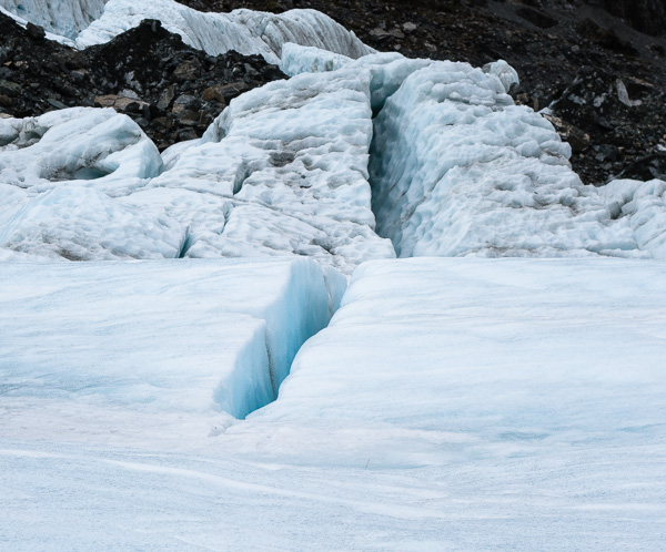 The start of a crevasse in the glacier.