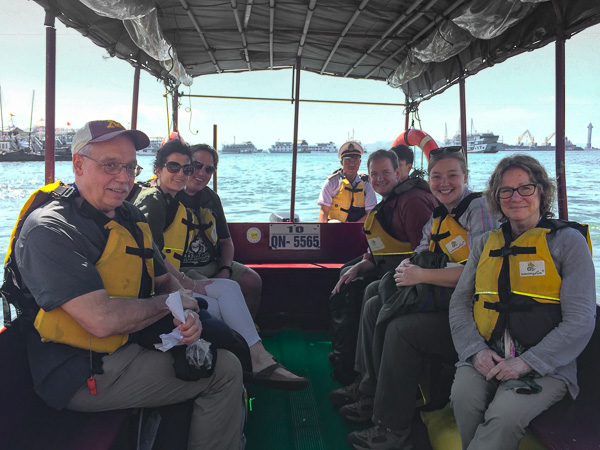 The crew on the small boat heading to the Red Dragon.